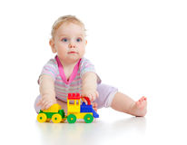 Cute little boy playing with colorful train Stock Photos