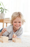 Cute little boy playing with dominoes Stock Photo