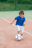 Cute little boy, playing football Stock Photography