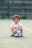 Cute little boy, playing football Royalty Free Stock Photo