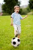Cute little boy, playing football Stock Images