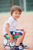 Cute little boy, playing football Stock Photo