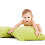 Cute little boy playing with green pillows Royalty Free Stock Photos