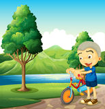 A cute little boy playing with his bike Royalty Free Stock Photo