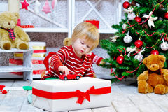 Cute little boy playing with his red toy car Stock Image