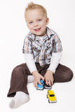 Cute Little Boy Playing with his Toys stock photos