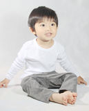 Cute little boy playing with his toys Royalty Free Stock Image