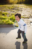 Boy playing jump rope Stock Photos
