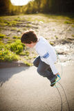 Boy playing jump rope Stock Photography