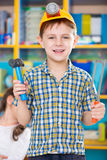 Cute little boy playing in kindergarten Royalty Free Stock Image