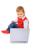 Cute little boy playing with laptop Stock Photography