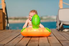Cute little boy playing with life buoy at the seaside Stock Images
