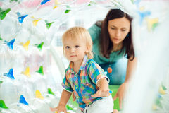 Cute little boy playing with mom on playground . Stock Photography