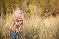 Cute Little Boy Playing Outdoors Royalty Free Stock Photography
