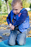 Cute little boy playing outdoors Stock Photos