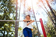 Little boy playing in park stock images