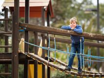 Cute little boy playing in the park outdoors royalty free stock photo