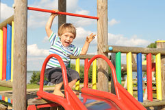 Cute little boy playing in the playground royalty free stock photography