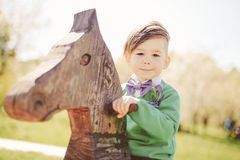 Cute little boy playing on the playground outdoor Royalty Free Stock Images