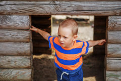 Cute little boy playing on the playground in the summer Stock Image