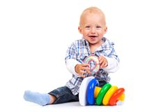 Cute little boy playing with pyramid toy Royalty Free Stock Image