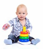 Cute little boy playing with pyramid toy Royalty Free Stock Photo
