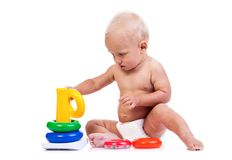Cute little boy playing with pyramid toy on white Royalty Free Stock Images
