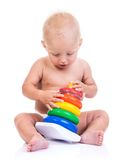 Cute little boy playing with pyramid toy on white Royalty Free Stock Photography