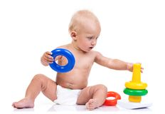 Cute little boy playing with pyramid toy on white Royalty Free Stock Image