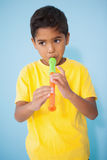 Cute little boy playing the recorder in classroom Stock Photo