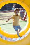 Cute little boy, playing in a rolling plastic cylinder ring, ful Royalty Free Stock Photography