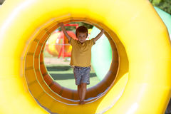 Cute little boy, playing in a rolling plastic cylinder ring, ful Royalty Free Stock Photo