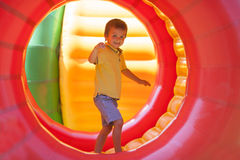 Cute little boy, playing in a rolling plastic cylinder ring, ful Stock Photo