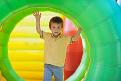 Cute little boy, playing in a rolling plastic cylinder ring, ful Stock Photography