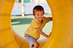 Cute little boy, playing in a rolling plastic cylinder ring, ful Stock Images