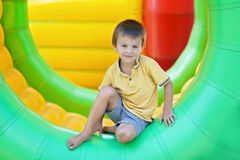 Cute little boy, playing in a rolling plastic cylinder ring, ful Royalty Free Stock Photos