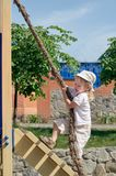 Boy playing on playground Stock Images