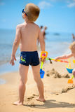 Cute little boy playing with sand Stock Images