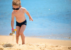 Cute little boy playing with sand Royalty Free Stock Image
