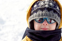 Boy in the snow. Cute little boy playing in the snow Stock Images