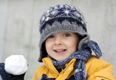 First snow excitement. Cute little boy playing in the snow Stock Photo