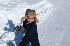 Cute little boy playing in the snow outdoors. Stock Image