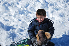 Cute little boy playing in the snow outdoors. Royalty Free Stock Photos