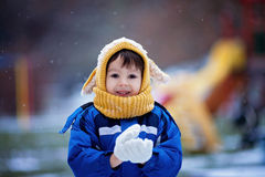 Cute little boy, playing with snow in the park, playground Stock Photography
