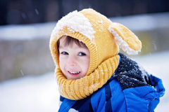 Cute little boy, playing with snow in the park, playground Royalty Free Stock Photo