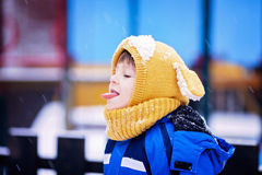 Cute little boy, playing with snow in the park, playground Stock Photo