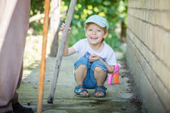 Cute little boy playing outdoors Royalty Free Stock Photo