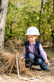 Cute Little Boy Playing with Sticks at the Woods Stock Photography