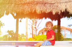 Cute little boy playing in swimming pool at beach Royalty Free Stock Photography
