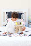 Cute little boy playing with a teddy bear Royalty Free Stock Photos